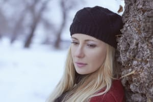 sad woman in snow blonde