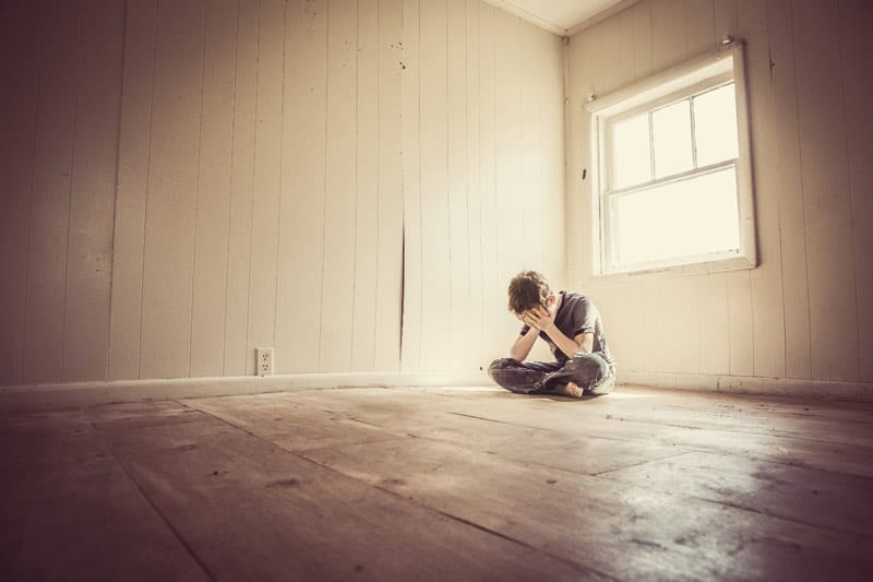 man alone in empty room