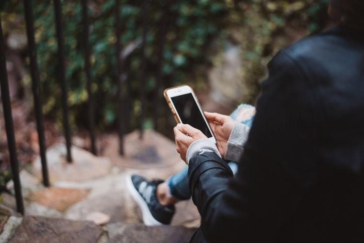 online counseling on phone outdoors