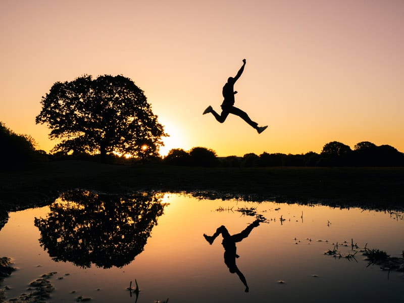 leaping man at sunset
