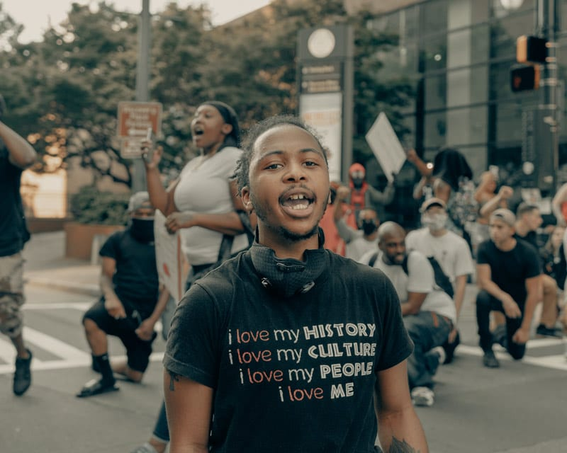 man in bipoc pride shirt