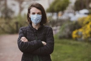 girl in medical face mask