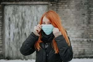 young woman with covid mask