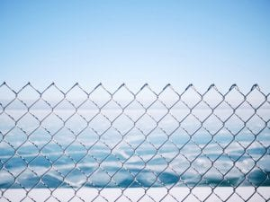 chain link fence on water