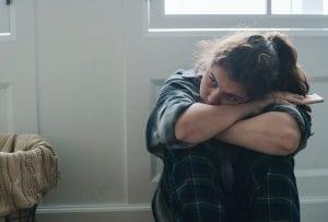 sad teen with smartphone.