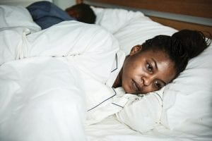 anxious black woman in bed