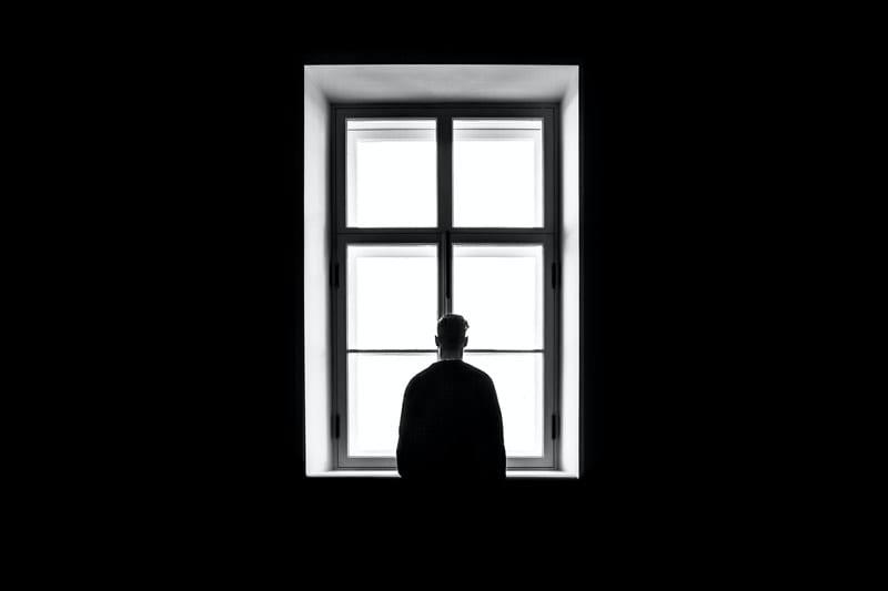 man alone in window