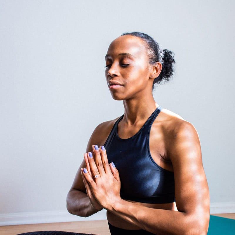black woman doing yoga