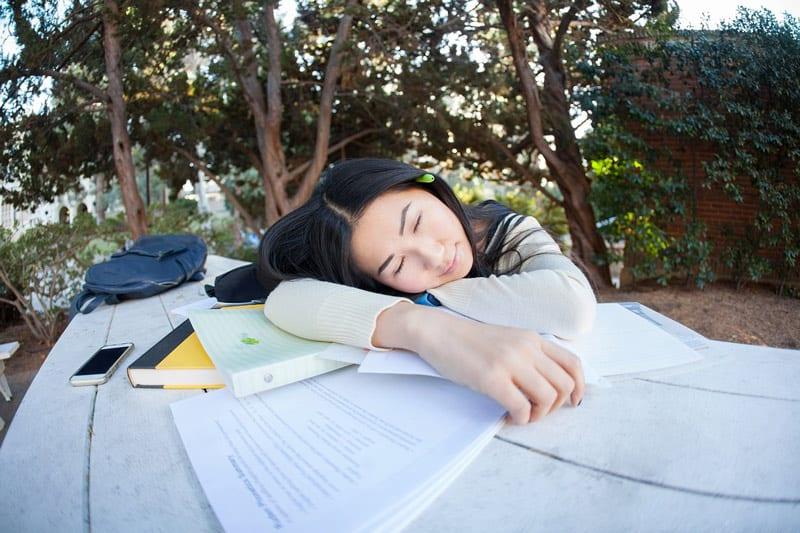 student asleep on table