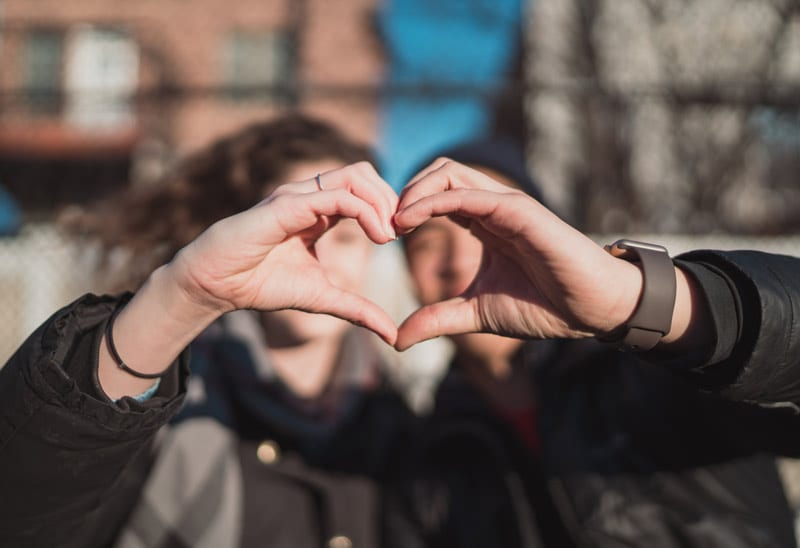 couple making heart sign
