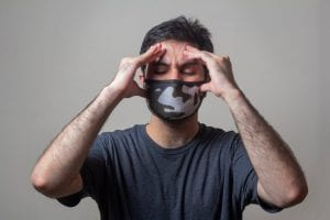 stressed man in face mask