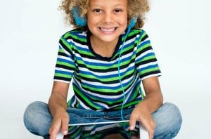 biracial kid with tablet