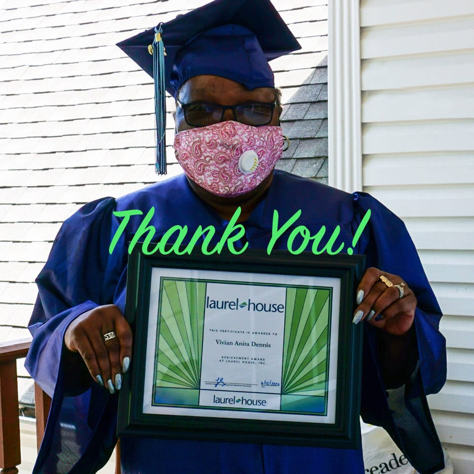 woamn in cap and gown with certificate