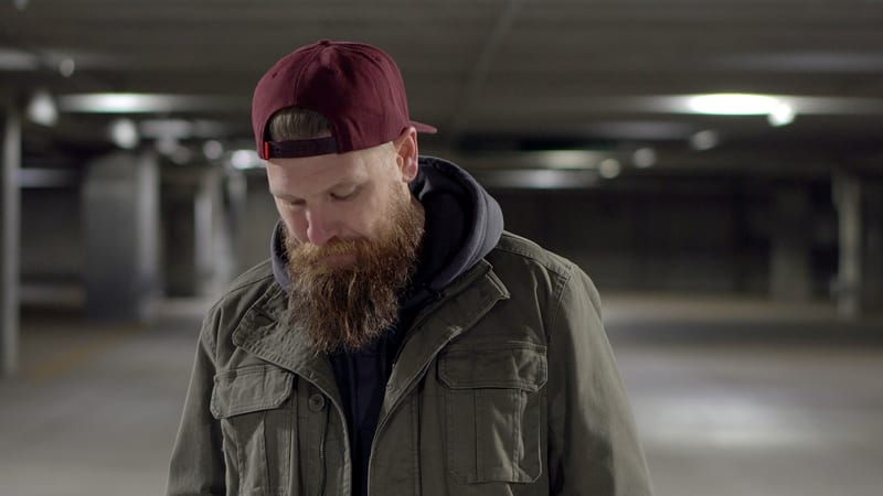 man with beard and baseball cap