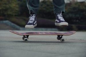 close up skateboard and feet
