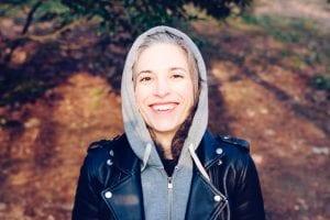 smiling woman in hoodie